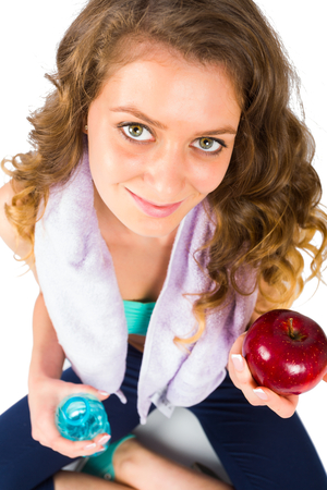 nourishment: Beautiful sporty woman living a healthy life with proper nourishment.