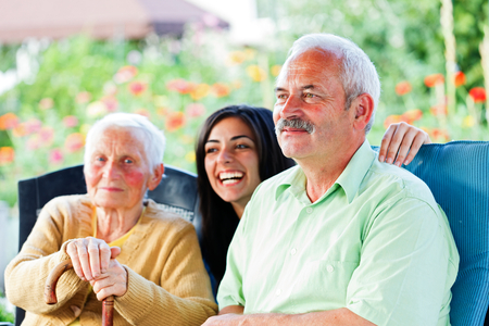 alzheimers: Smiling old man visiting her elderly  mother.