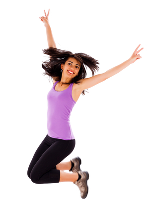 Beautiful fit young lady jumping enjoying her healthy life. photo