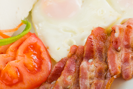 sunnyside: Delicious fried sunny-side up with vegetables and bacon.