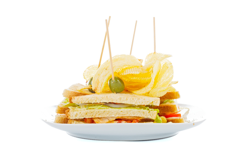 sandwitch: Tasty sandwitch of fresh ingredients with potato chips.