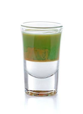 liqueurs: A special mix of liqueurs: whiskey, mint and cocoa liqueur cocktail shot.