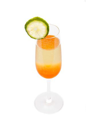 mash: Special cocktail with champagne and peach mash decorated with lime. Stock Photo