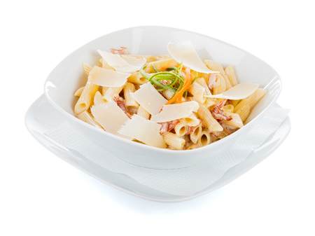 Parmesan: Carbonara sauce penne with parmesan and ham. Stock Photo