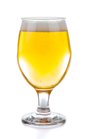draught: A glass of fresh draught blond beer.