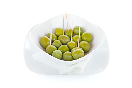 plateful: A plateful of raw green olives isolated on white.