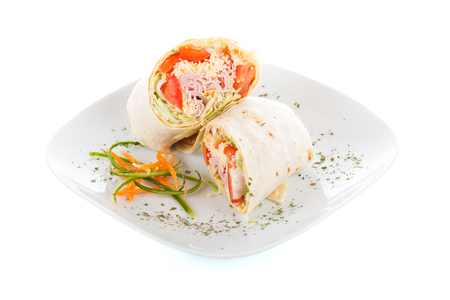 tortillas: Tasty wrap of ham and fresh vegetables. Stock Photo