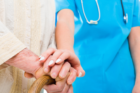 hospital care: Caring doctor supporting elderly patient in her struggle - residential care.
