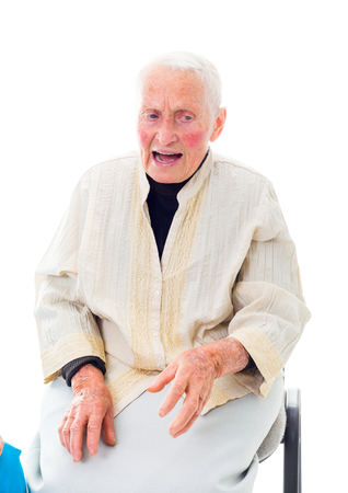 disease patients: A senior person being in a wholehearthed conversation, talking on a chair isolate on white.