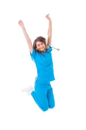 practitioner: Jumping young practitioner doctor happy for her success.