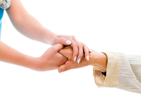 help: Supporting hands for senior woman - doctor and elderly patient. Stock Photo