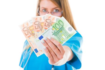 doctor money: Doctor with her money in blue coat.