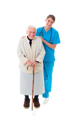 caretaker: Beautiful young caretaker supporting a sick elderly woman.