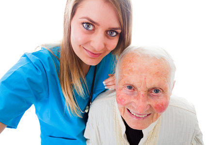 taken: Happy elderly patient and doctor on a photograph taken by the healtcare worker - recovery selfie.