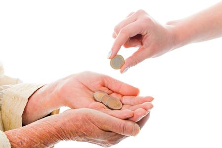 gente pobre: Persona joven donar dinero a mendigos alto - Euro en la imagen. Foto de archivo