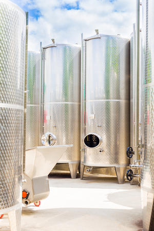 vintages: Outdoor fermentation tanks for making wine. Stock Photo