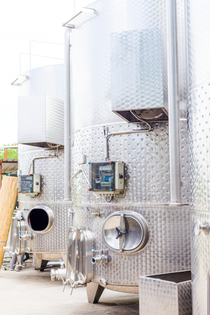 fermentation: Fermentation tanks outdoors for making wine in industrial quantity. Stock Photo
