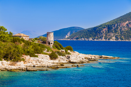 intact: The original Venetian lighthouse. The old lighthouse is reasonably intact and the keeper s house and garden are in good condition. The location is Fiskardo, Kefalonia, the shore towards Itaka.