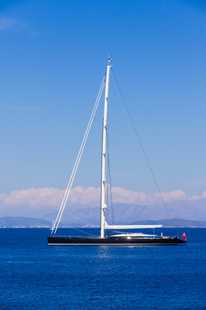 mediterranian: Big hybrid - motorized and sailing -  luxury yacht with sails floating through the Mediterranean sea.