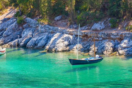 mediterranian: A small fishing boat levitating on the surface of the salty water of the Mediterranian sea shores.