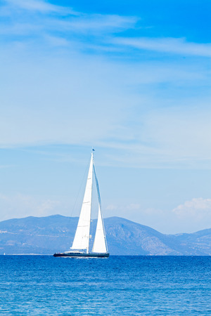 mediterranian: Beautiful hybrid cruising yacht traveling through the seas with the sails open.