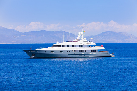 motorized: Beautiful motorized yacht swimming in the Ionian sea from the Mediterranean sea. Stock Photo
