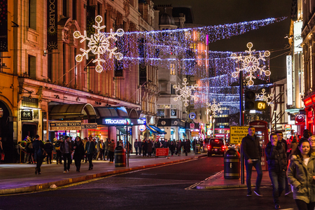 usual: London street before Christmas with the the usual agglomeration of the night.