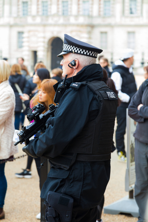 anti terrorist: An armed guard resposable for the anti terrorist security of London surveilling an event at the Household Cavalry Museum. Editorial