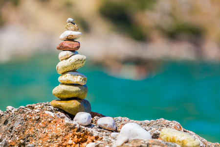 balanced rocks: A pile of a well balanced rocks on the beach usable for simple backgrounds or balance and meditation concepts. Stock Photo