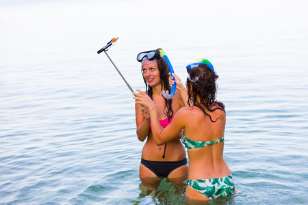mediterranian: Girls getting ready for the selfie in the salty waters of the Mediterranian sea.