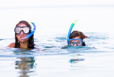 mediterranian: Swimming together in the Mediterranian sea with snorkeling equipment