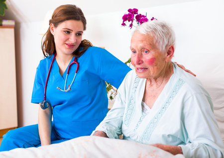 geriatrician: Geriatric doctor listening to the elderly woman patient with attention and care.