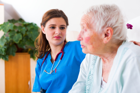 geriatric: Geriatric doctor listening to the elderly woman patient with attention and care.