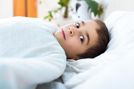 terrify: Little boy at morning, waking up early.