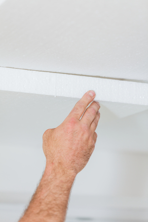 thermal insulation: Constructor insulating the ceiling from the interior with polyethilene foam for thermal insulation.
