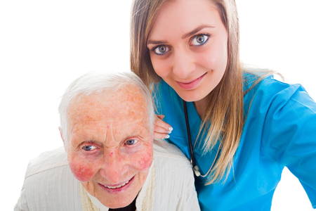 Doctor taking a selfie with senior patient to show family the recovering granny's conditions photo