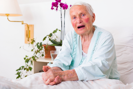 believing: Elderly woman telling her problems to the listener. Sickness is hard at this age. Stock Photo
