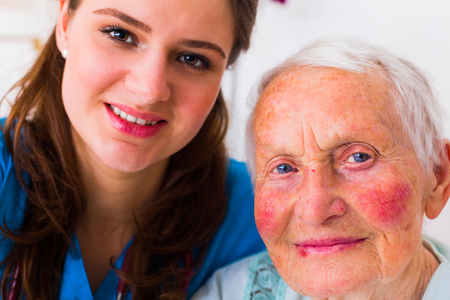 incapacity: Nurse and elderly patient taking a selfie to send it to the relatives to show that everything is going well.