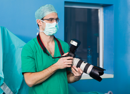 Medical student documenting the surgical pocedure in the emergency room.