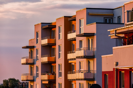 Modern multi story building being lit by the setting sun at afternoon. Stock fotó