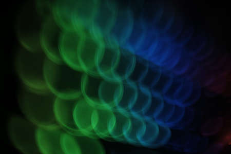 blurry background pic , swirly linear colorful rounded lights pattern on black