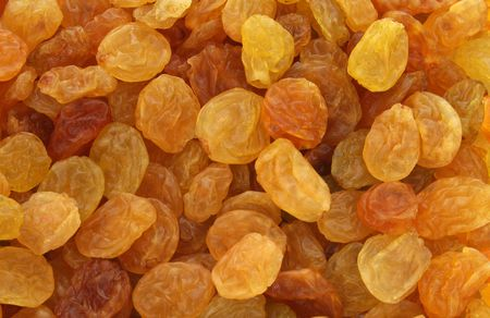 wei�e trauben: Hintergrund der goldenen, gelb und braun gl�nzende Rosinen aus wei�en Trauben