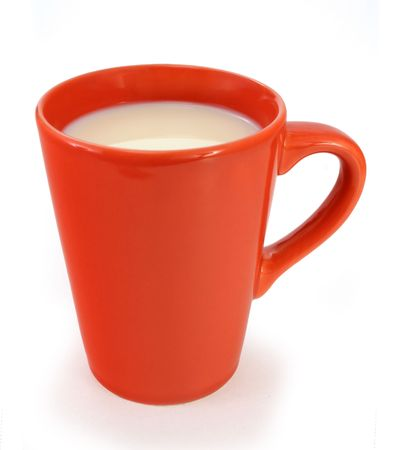 lactation: Milk in a bright red cup isolated Stock Photo