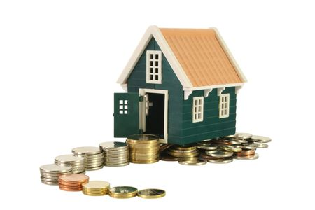path to wealth: Ascending and winding money road leading to a house - isolated (clipping path)