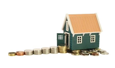 homeownership: Savings - the road to homeownership. Stairs made of money leading to a house - isolated (clipping path)