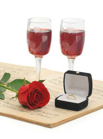 Preparing to propose her - with all the classic elements - rose, red wine, music and the ring (isolated, clipping path) Stock Photo - 794973