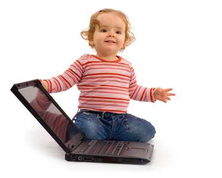 Understanding computer technology, the basics - one year old girl - future businesswoman - with laptop Stock Photo - 801176