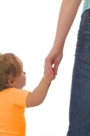 Baby girl holding her mother's hand - concept for childhood and parenthood Stock Photo - 795265