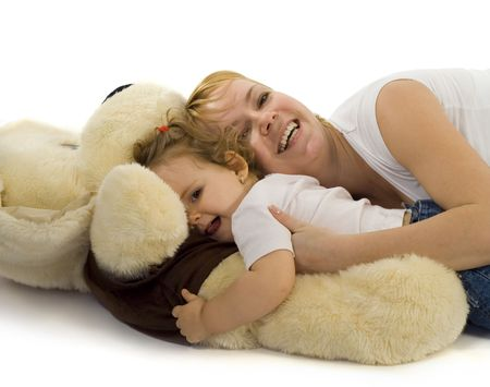Young mother playing with her  girl and a giant plush dog Stock Photo