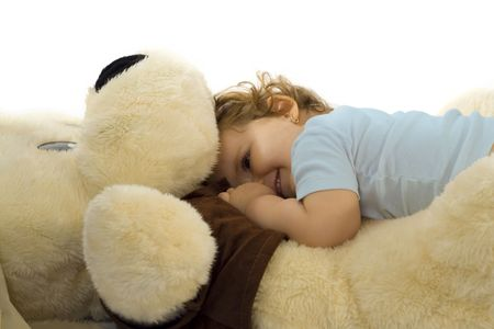 One year old girl playing with giant plush dog Stock Photo - 801181